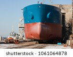 Small photo of Shipbuilders complete construction of a large seagoing vessel