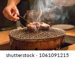 chef cooking beef steak in... | Shutterstock . vector #1061091215
