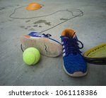 tennis equipment with shoes... | Shutterstock . vector #1061118386