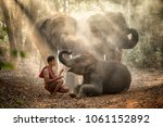 Stock photo the elephants in forest and mahout with baby elephant lifestyle of mahout in chang village surin 1061152892