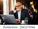 mature cheerful businessman is...   Shutterstock . vector #1061172566