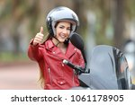 happy biker looking at you with ... | Shutterstock . vector #1061178905