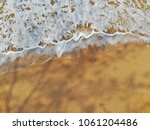 emerald green sea and orange... | Shutterstock . vector #1061204486