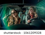 two friends having fun on the... | Shutterstock . vector #1061209328