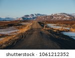 empty rural road and snow... | Shutterstock . vector #1061212352