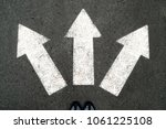 three white arrows pointing in... | Shutterstock . vector #1061225108