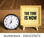 Small photo of Motivational and inspirational quotes - 'The time is now' written on framed paper. With vintage styled background.