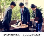 business people greeting bowing ... | Shutterstock . vector #1061269235