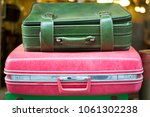 old suitcase aka luggage in the ... | Shutterstock . vector #1061302238