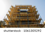 scaffolding attached to the... | Shutterstock . vector #1061305292