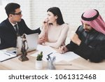 lawyer in suit in office with... | Shutterstock . vector #1061312468