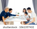 happy asian extended family... | Shutterstock . vector #1061357432