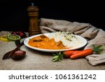 handmade indian curry chicken... | Shutterstock . vector #1061361242