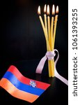 Forget-me-not- symbol of centennial of Armenian Genocide in Ottoman Empire- and flag of Armenia, burning candles. Day of Remembrance of Victims of announced on April 24