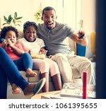 african family spending time... | Shutterstock . vector #1061395655
