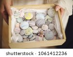 a box of pastel badges