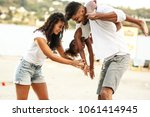 young mixed race family hangout ... | Shutterstock . vector #1061414945