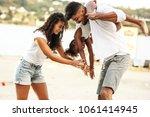 young mixed race family hangout ... | Shutterstock . vector #1061414945