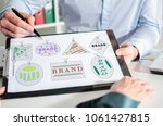 Small photo of Businessman showing brand concept on a clipboard