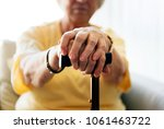 senior woman holding a walking... | Shutterstock . vector #1061463722