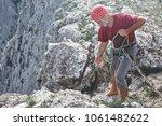 old aged man rock climber... | Shutterstock . vector #1061482622