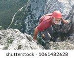 old aged man rock climber... | Shutterstock . vector #1061482628