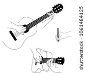 guitar and hands isolated on...   Shutterstock .eps vector #1061484125