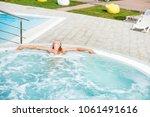 beautiful woman in outdoor... | Shutterstock . vector #1061491616