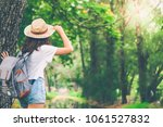 woman in the forest. freedom...   Shutterstock . vector #1061527832