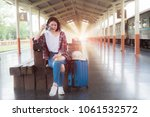 asian young traveler woman with ... | Shutterstock . vector #1061532572