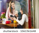 three happy beautiful young... | Shutterstock . vector #1061561648