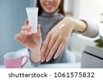 close up of girl's hands. she... | Shutterstock . vector #1061575832