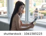 young woman holding credit card ... | Shutterstock . vector #1061585225