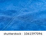 Small photo of Fabric texture with seam stitch seam. Abstract background, empty template. Selective focus.