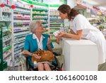 female pharmacist taking...   Shutterstock . vector #1061600108