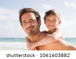 a father and giving his son a... | Shutterstock . vector #1061603882