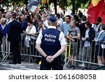police officers check the crowd ... | Shutterstock . vector #1061608058