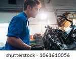 professional mechanic repairing ... | Shutterstock . vector #1061610056