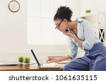 concentrated african american...   Shutterstock . vector #1061635115