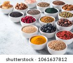 various superfoods in smal bowl ... | Shutterstock . vector #1061637812