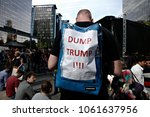 activists protest against... | Shutterstock . vector #1061637956