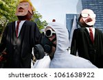 activists wear masks during... | Shutterstock . vector #1061638922
