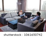 young couple relaxing at home... | Shutterstock . vector #1061650742