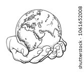 earth in hands in retro style.... | Shutterstock .eps vector #1061652008