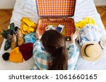 woman sit on bed with suitcase... | Shutterstock . vector #1061660165