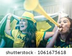 Stock photo brazilian fan celebrating during soccer match at home 1061675618