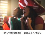 mexican fan celebrating during... | Shutterstock . vector #1061677592