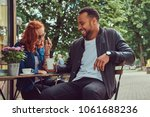 a couple dating drinking coffee ... | Shutterstock . vector #1061688236