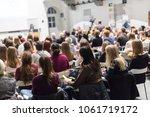 female speaker giving... | Shutterstock . vector #1061719172