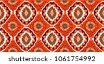 ikat geometric folklore... | Shutterstock .eps vector #1061754992